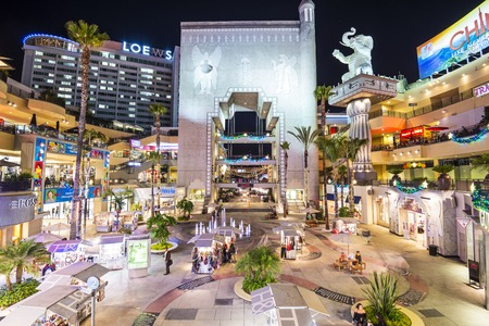 HOLLYWOOD, CALIFORNIA - NOVEMBER 8, 2013: Hollywood and Highland complex at night.  Located along the Hollywood Walk of Fame, it is among the most visited tourist destinations in Los Angeles.