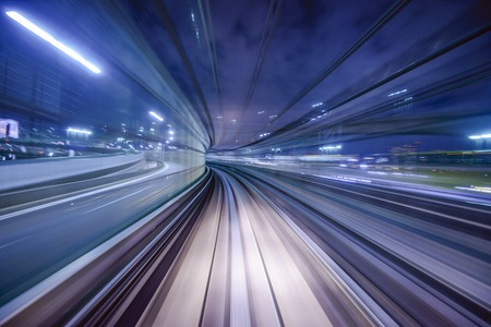 railway transportation: Monorail motion blur on the Yurikamome in Tokyo, Japan. Stock Photo
