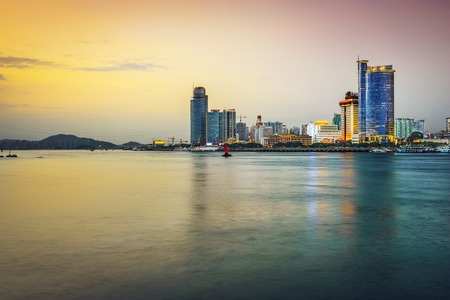 water scape: Xiamen, China skyline at twilight.