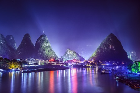 river: Yangshuo, China cityscape and karst mountains on the Li River.