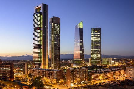 tower: Madrid, Spain financial district skyline at twilight.