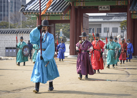 SEOUL - FEBRUARY 14: Royal guards at Gyeongbokgung Palace February 14, 2013 in Seoul, ROK. Guards have been in place at the palace, once the home of the king, since the 14th century. Editorial