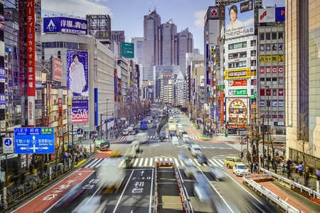 TOKYO, JAPAN - MARCH 18, 2014: Traffic at Shinjuku district. Shinjuku is the commercial and administrative center of the city. Editorial
