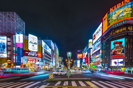 districts: SAPPORO, JAPAN - OCTOBER 17, 2012: Traffic passes through the Susukino District. Susukino is one of the three major red-light districts within Japan.