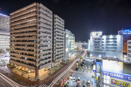 okinawa: NAHA, JAPAN - NOVEMBER 12, 2014: Apartments and shops in downtown Naha, Okinawa. The city is the most populous in Okinawa.