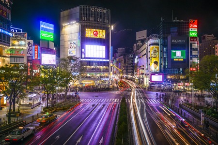 centers: TOKYO, JAPAN - MARCH 30, 2014: Shibuya Ward at Shibuya crossing is one of Tokyos major nightlife and fashion centers.