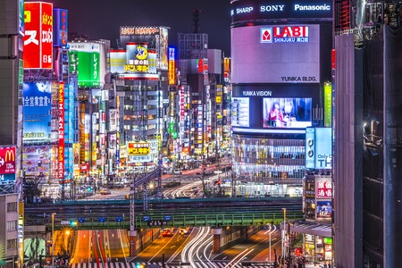 TOKYO, JAPAN - MARCH 19, 2014: Shinjuku district illuminated at night. The district is a renown night life center. Editorial