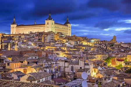 toledo town: Toledo, Spain town skyline at the Alcazar at dawn.