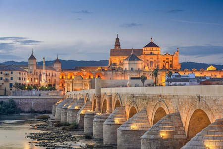 spanish culture: Cordoba, Spain view of the Roman Bridge and Mosque-Cathedral on the Guadalquivir River. Stock Photo