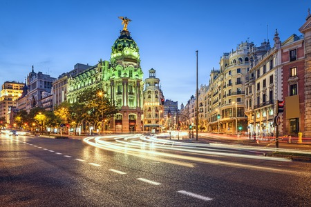 landmarks: Madrid, Spain cityscape on Gran Via at twilight. Stock Photo