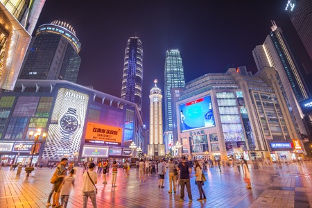 lapse: CHONGQING, CHINA - JUNE 1, 2014: People stroll through the Jiefangbei CBD pedestrian mall. The district is considered the most prominent financial district in the interior of China. Editorial