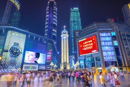 CHONGQING, CHINA - JUNE 1, 2014: People stroll through the Jiefangbei CBD pedestrian mall. The district is considered the most prominent financial district in the interior of China. 報道画像
