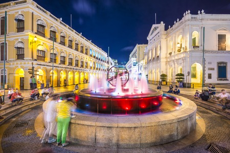 MACAU, CHINA - MAY 21, 2014: People enjoy Senado Square. The territory was the last European colony in Asia and the architecture is inspired by the former Portuguese rule. Redakční