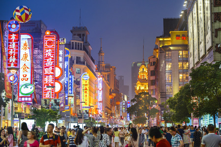 shanghai skyline: SHANGHAI, CHINA - JUNE 16, 2014: Neon signs lit on Nanjing Road. The street is the main shopping road of the city.