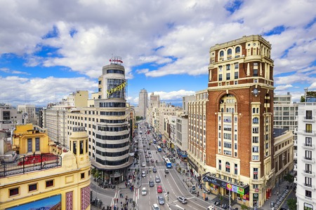 iconic: MADRID, SPAIN - OCTOBER 15, 2014: Gran Via at the Iconic Schweppes Building. The street is the main shopping district of Madrid.