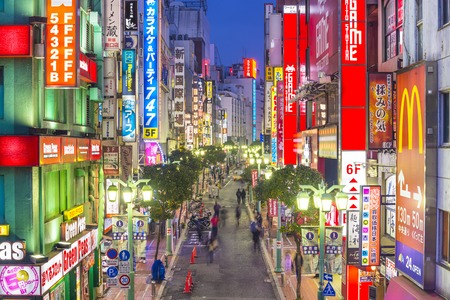 night life: TOKYO, JAPAN - DECEMBER 17, 2012: Nightlife in theShinjuku District. The area is a famed nightlife and red-light district.