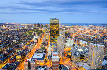 night view: Boston, Massachusetts, USA aerial view of the downtown cityscape.