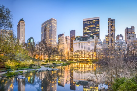 New York City, USA Manhattan cityscape from the Lagoon in Central Park.
