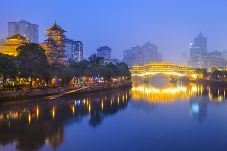 Chengdu, Sichuan, China cityscape over the Jin River.