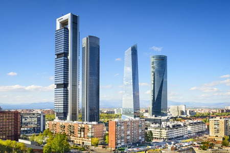 paseo: Madrid, Spain financial district skyline.