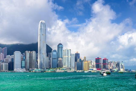 hk: Hong Kong, China city skyline at Victoria Harbor. Stock Photo