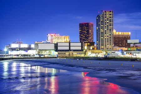 jersey: Atlantic City, New Jersey, USA resort casinos cityscape on the shore at night.
