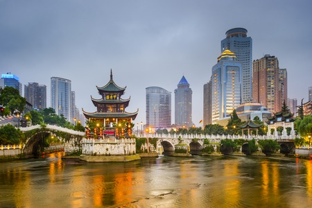 Guiyang, China city skyline on the river. Imagens