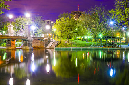 commons: Lagoon Bridge and skyline of Boston, Massachusetts fromthe Boston Public Gardens.