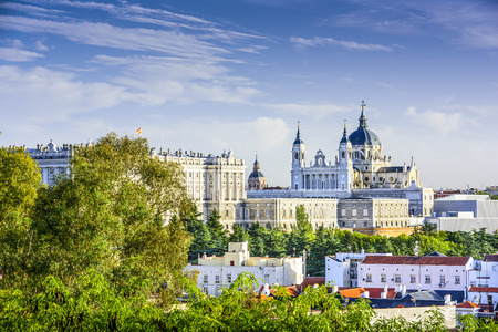city park skyline: Madrid, Spain skyline at Santa Maria la Real de La Almudena Cathedral and the Royal Palace.