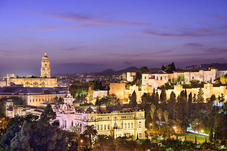Malaga, Spain cityscape at the Cathedral, City Hall and Alcazaba Moorish fort. photo