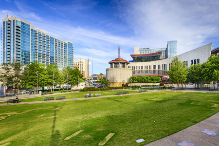 music hall: NASHVILLE, TENNESSEE - JUNE 14, 2013: Country Music Hall of Fame viewed from Music City Walk of Fame Park.