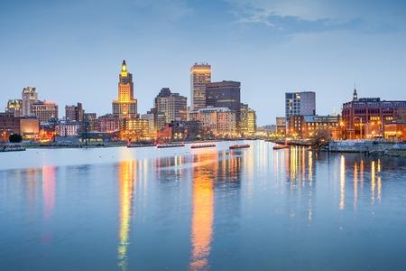 Providence, Rhode Island, USA city skyline on the Providence River at twilight.