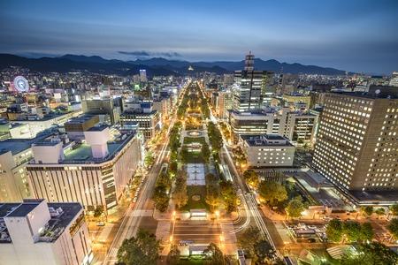 japan sunset: Sapporo, Japan downtown city skyline at Odori Park.