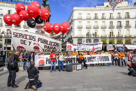 privatization: MADRID, SPAIN - OCTOBER 17, 2014: Crowds at Puerta del Sol Plaza protest the privatization of state-owned airport operator Aena Aeropuertos. The plan has met much opposition.