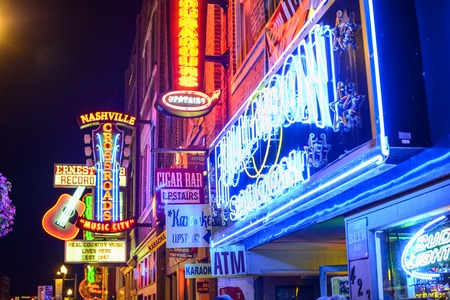 NASHVILLE, TENNESSEE - JUNE 16, 2013: Honky-tonks on Lower Broadway. The district is famous for the numerous country music entertainment establishments.