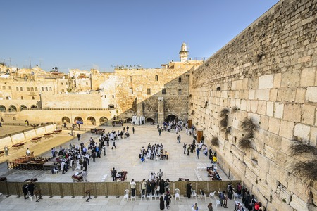 JERUSALEM, ISRAEL - FEBRUARY 20, 2012: Worshipers pray at the western wall. The wall is the most sacred site in Judaism outside of the Temple Mount itself.