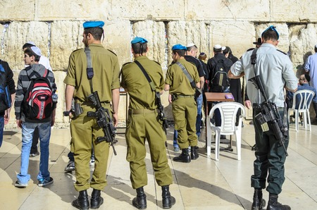israeli: JERUSALEM, ISRAEL - FEBRUARY 23, 2012: Israeli Soldiers stand guard at the Western Wall.
