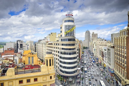 gran via: MADRID, SPAIN - OCTOBER 15, 2014: Gran Via at the Iconic Schweppes Building. The street is the main shopping district of Madrid.
