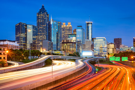 infrastructure buildings: Atlanta, Georgia, USA downtown city skyline over the interstate.
