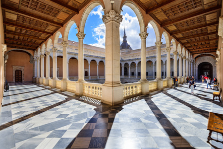 spain: TOLEDO, SPAIN - NOVEMBER 11, 2014: Alcazar of Toledo, Spain at the interior courtyard. Once used as a Roman palace, the Spanish restored the Alcazar in the 16th Century. Editorial