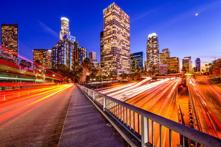 los angeles: Los Angeles, California, USA downtown city skyline over the highway. Stock Photo