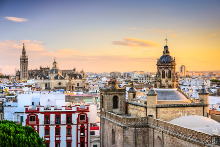 famous place: Seville, Spain city skyline at dusk.