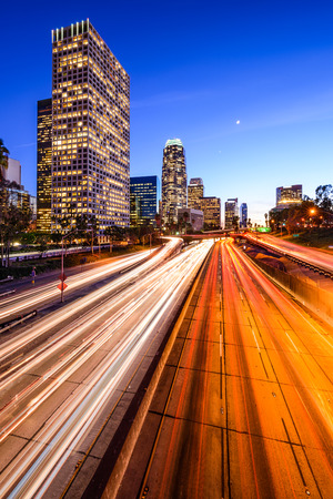 los angeles county: Los Angeles, California, USA downtown city skyline over the highway. Stock Photo