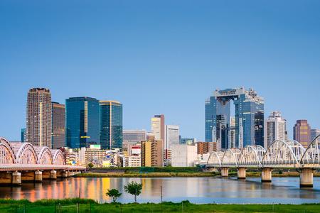 travel japan: Osaka, Japan skyline at Umeda from across the Yodogawa River.