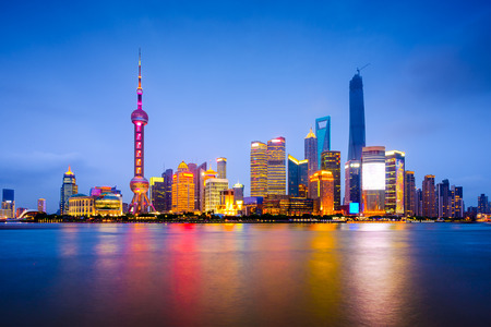 business asia: Shanghai, China city skyline on the Huangpu River.