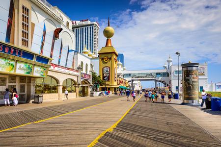 city hotel: ATLANTIC CITY, NEW JERSEY - SEPTEMBER 9, 2012: Tourists walk on the boardwalk in Atlantic City.