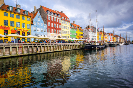 17th: COPENAGEN, DENMARK - SEPTEMBER 15, 2013: Waterfront of Nyhavn canal. The bar-lined waterfront dates from the 17th century.