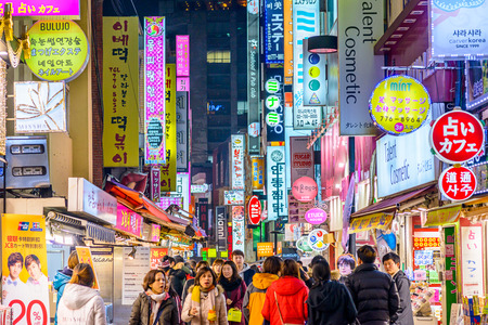 korea: SEOUL, SOUTH KOREA - FEBRUARY 14, 2013: Crowds enjoy the Myeong-Dong district nightlife in Seoul.