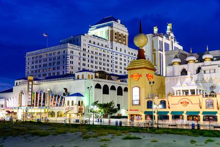 atlantic city: ATLANTIC CITY, NEW JERSEY - SEPTEMBER 8, 2012: Casinos line the Atlantic City boardwalk at dusk.