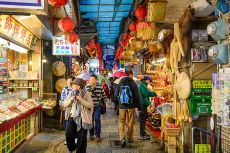 JIUFEN, TAIWAN - JANUARY 17, 2013: Tourists stroll through quaint alleys of Jiufen. The town is a tourist attraction renown for a its unique atmosphere. Reklamní fotografie - 36840671